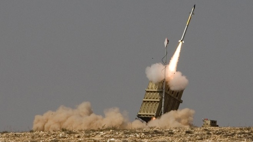 In this Sunday, Aug. 21, 2011 file photo, a rocket is launched from a new Israeli anti-missile system known as Iron Dome in order to intercept a rocket fired by Palestinian militants from the Gaza Strip, in the southern city of Beersheba, Israel.