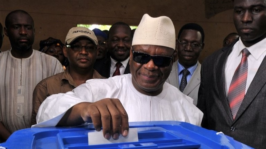 Mali's presidential candidate Ibrahim Boubacar Keita casts his vote at the polling station in Bamako on August 11, 2013. Keita was set for victory in the presidential election runoff after his rival conceded defeat, and now faces a daunting task of rebuilding a country reeling from more than a year of turmoil including a military coup and war.