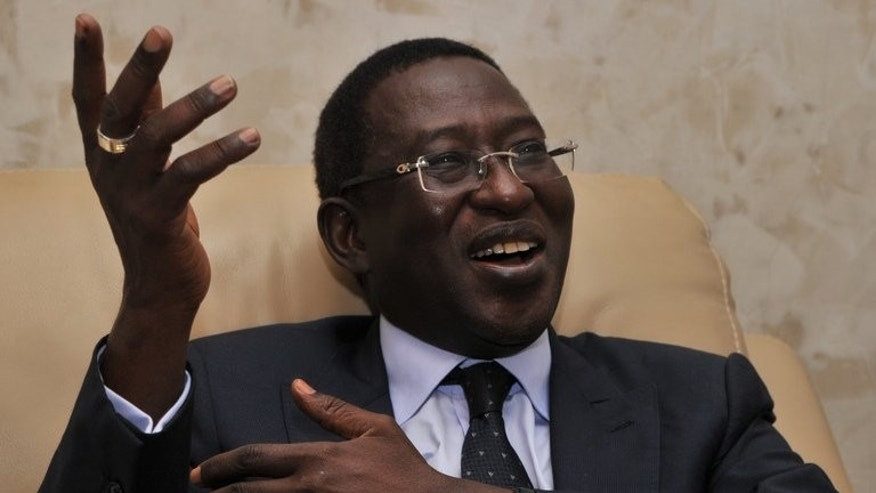 Former Malian finance minister Soumaila Cisse speaks at his house in Bamako on August 12, 2013. Mali's former prime minister Ibrahim Boubacar Keita was set for victory in the presidential election runoff after his Cisse conceded defeat, and now faces a daunting task of rebuilding a country reeling from more than a year of turmoil including a military coup and war.