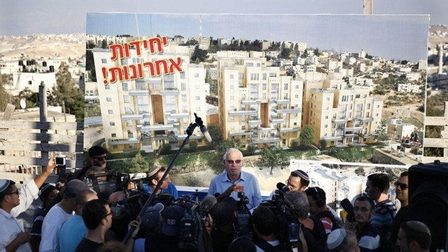 Israeli Housing Minister Uri Ariel speaks to the press during a promotion event for new housing units in the Jewish neighborhood of Armon Hanatsiv in annexed east Jerusalem on August 11, 2013.With a new peace dialogue in its fledgling moments after a three-year halt, the approval of almost 800 housing units in annexed east Jerusalem and around 400 elsewhere in the West Bank infuriated Palestinians