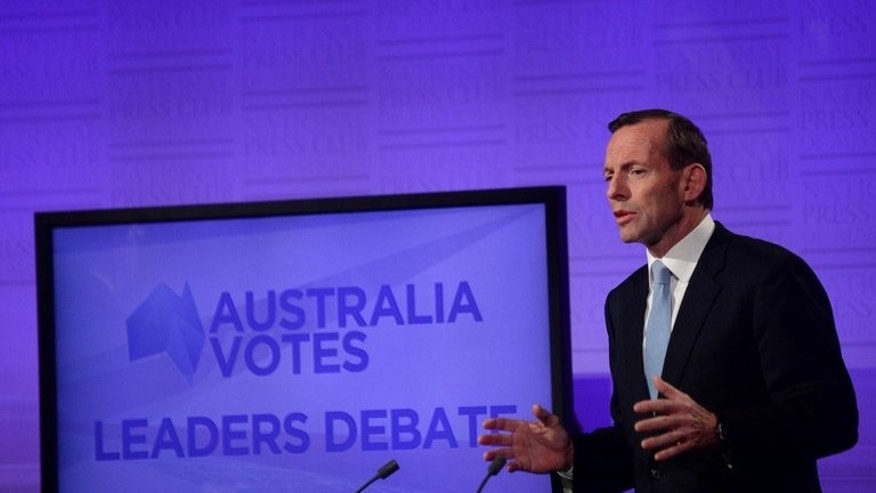 Conservative opposition leader Tony Abbott speaks during a debate with Australian PM Kevin Rudd on August 11, 2013. Abbott came under fire after praising a female conservative colleague's sex appeal while campaigning in western Sydney on Tuesday.
