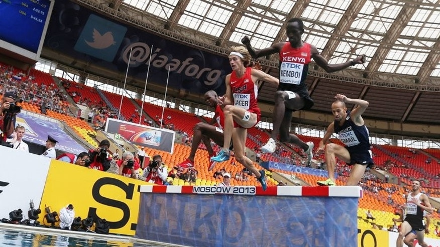 (From L) US athlete Evan Jager, Kenya's Ezekiel Kemboi and France's Noureddine Smail compete in the men's 3,000m steeplechase event at the 2013 IAAF World Championships at the Luzhniki stadium in Moscow, on August 12, 2013.