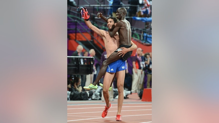 In this file photo, Kenya's Ezekiel Kemboi (R) and France's Mahiedine Mekhissi-Benabbad celebrate after winning respectively gold and silver in the men's 3,000m steeplechase final during the London 2012 Olympic Games, on August 5, 2012. Their friendship will have to be set aside for the fourth time in a major championship final when they line-up on Thursday at the World Championships in Moscow.