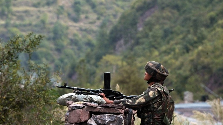 "An Indian soldier on the Line of Control (LOC) -- which divides the Himalayan territory between India and Pakistan -- near Kaman, on October 9, 2008. Pakistani Prime Minister Nawaz Sharif has called for a ""new beginning"" in relations with India amid high tension over the disputed region of Kashmir."