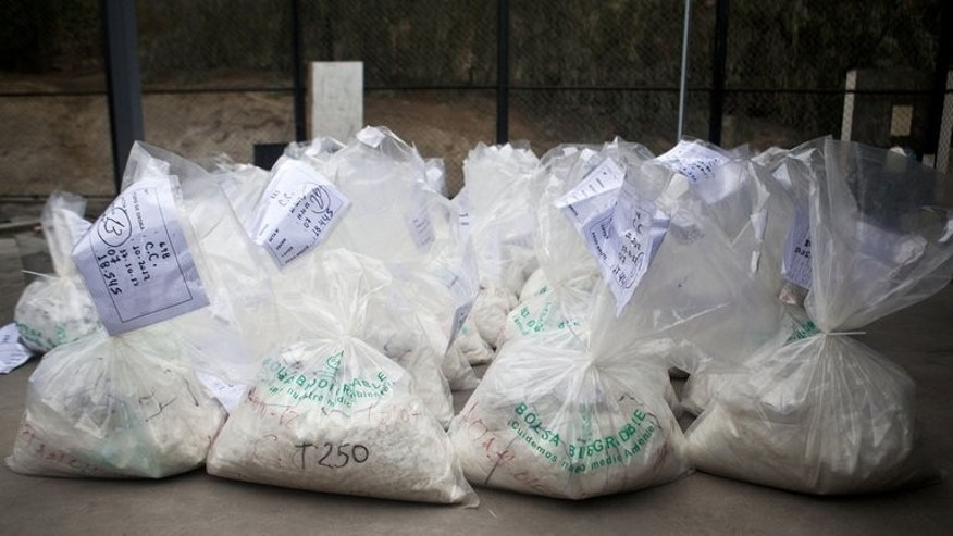 This file photo shows bags filled with cocaine, to be burned by workers of the Peruvian Ministry of Interior, at a police facility on the outskirts of Lima, on October 30, 2012. Two British women caught in Peru with ??1.5 million worth of cocaine claim that Ibiza gangsters forced them at gunpoint into becoming drug mules, in comments published in Wednesday's Daily Mirror.