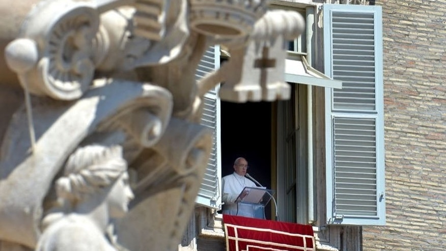 Pope Francis delivers his Sunday Angelus prayer from the window of his apartment to pilgrims gathered in St. Peter's Square at Vatican, August 11, 2013. The Pope joked with Italy and Argentina players on the eve of a friendly football match in Rome on Tuesday, saying he was torn over who to support.