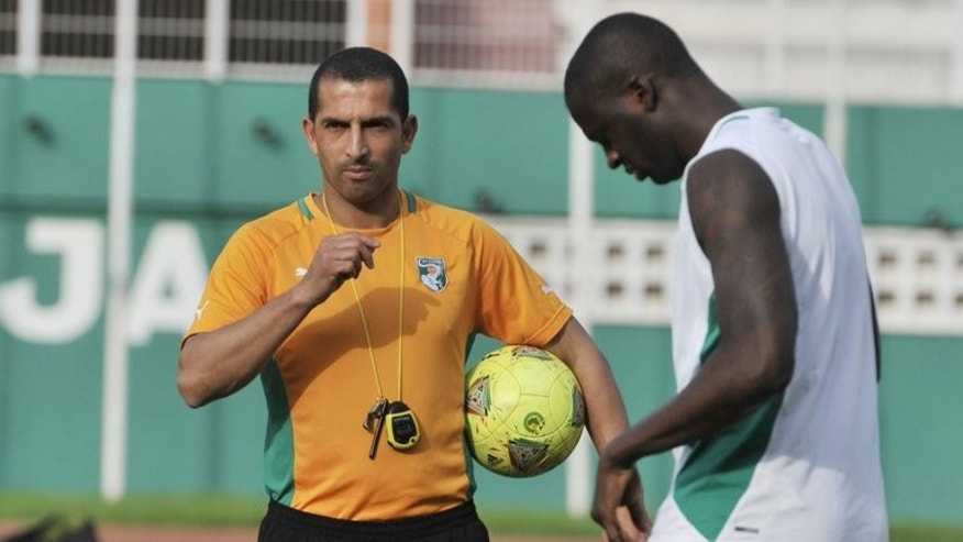Ivory Coast's national team coach Sabri Lamouchi (L), seen during a training session at the Felix Houphouet-Boigny stadium in Abidjan, on March 21, 2013.