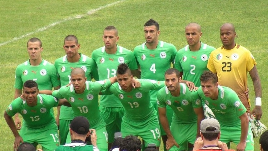 Algeria's national football team pose for a photo before a 2014 FIFA World Cup qualifying against Benin, on June 9, 2013, at the Charles de Gaulle stadium in Porto-Novo, Benin. Algeria host Guinea in a friendly on August 14.