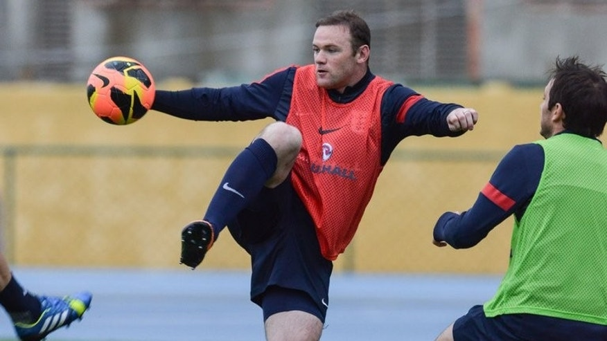 Wayne Rooney takes part in a training sesssion in Rio de Janeiro, Brazil on May 31, 2013. England manager Roy Hodgson will hope his side can banish the Rooney transfer sideshow from the sports pages by beating Scotland in a friendly.