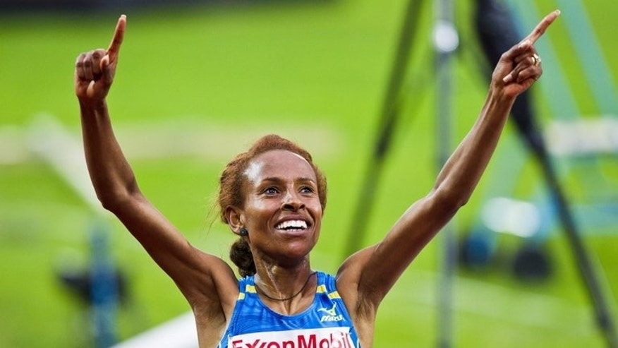 Ethiopia's Meseret Defar celebrates after winning the 5,000m event at the Diamond League event in Oslo on June 13, 2013. Defar gets a first run out in the 5,000m after being pulled from a 10,000m showdown with teammate Tirunesh Dibaba.