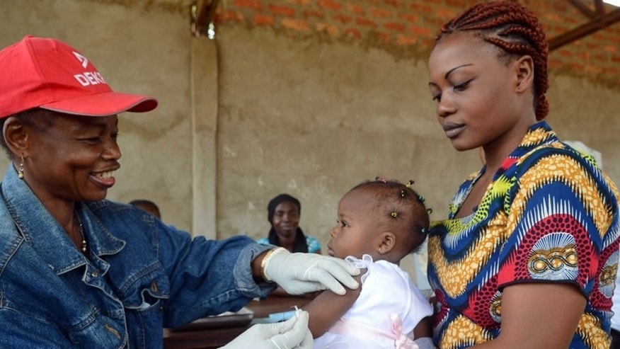 A baby girl gets a shot against measles during an vaccination program at the Bigoua hospital near Bangui on July 22, 2013. A severe measles epidemic has affected the whole territory of the Central African Republic, which lacks any strong health infrastructure, Health Minister Aguid Sounouk announced