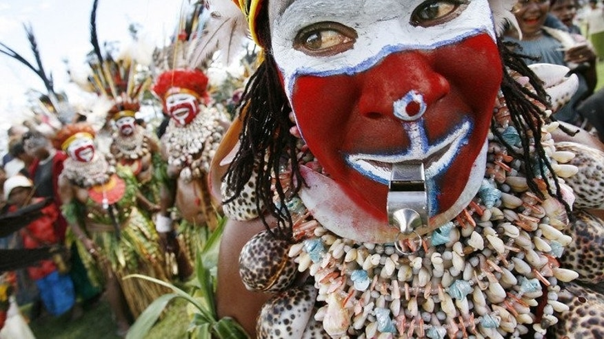 "This file illustration photo shows Moki Angimb women performing during a cultural show in Mount Hagen, on August 18, 2007. Women in poverty-stricken Papua New Guinea suffer ""severe brutality"" with violence, including savage attacks involving knives, axes and whips, occurring in two-thirds of all families, according to a recent study."