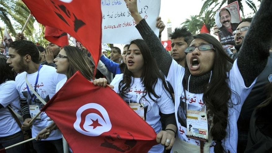 Tunisian women shout slogans during a demostration in the center of Tunis on March 26, 2013. Supporters and opponents of Tunisia's Islamist-led government were expected to flood the streets of the capital in rival rallies marking national women's day, after a bid to resolve a weeks-old crisis foundered.