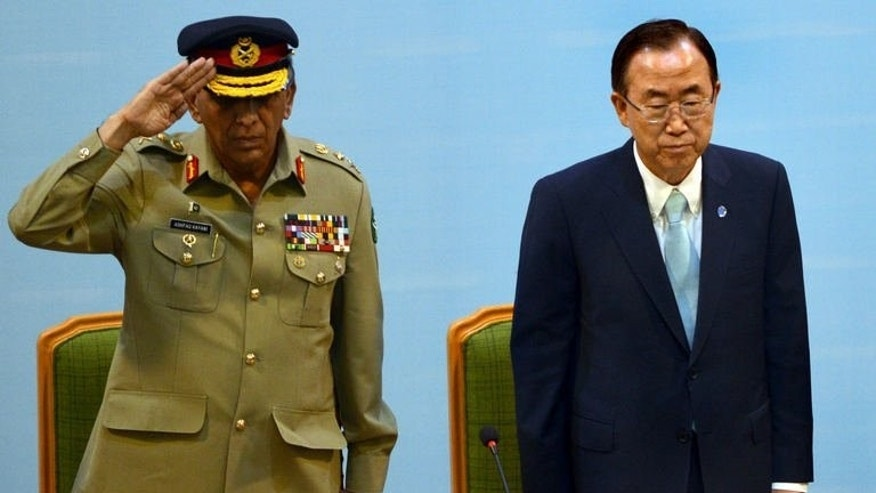 UN Secretary-General Ban Ki-moon (right) stands with Pakistan's army chief General Ashfaq Kayani during a ceremony in Islamabad, on August 13, 2013. Ban has waded into the controversy surrounding US drone strikes during a visit to Pakistan Tuesday, insisting they must operate within international law.