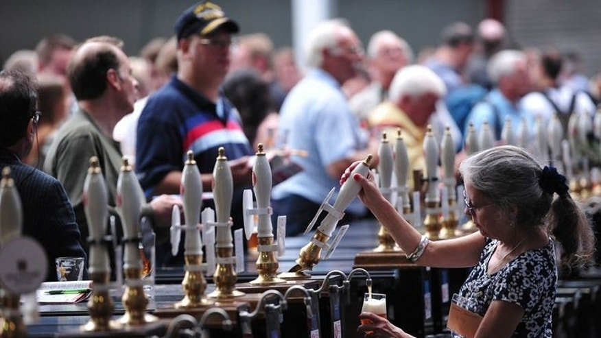A bartender pours a beer during the opening day of the Great British Beer Festival, organised by the Campaign for Real Ale (CAMRA), in west London on August 13, 2013. A Yorkshire brew was crowned champion beer of Britain as the Great British Beer Festival kicked off in London on Tuesday.