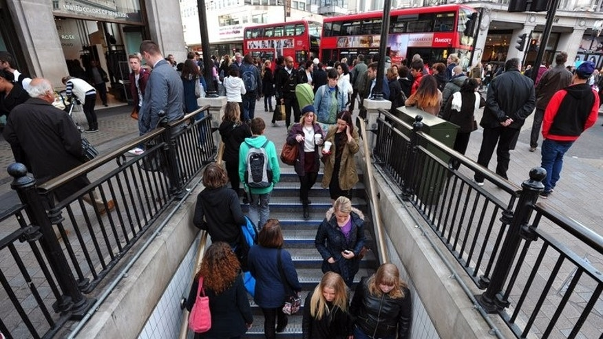 People enter an underground station in central London on October 17, 2012. Britain's unemployment rate remains at 7.8 percent, significantly above a level that could trigger the Bank of England to raise its main interest rate, official data showed on Wednesday.