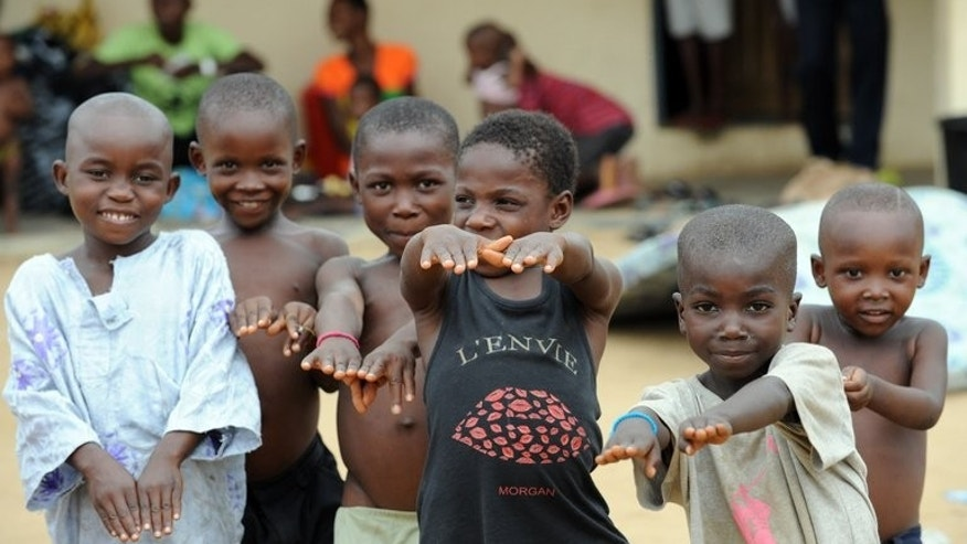 Displaced children of Bakassi Peninsula play games to ease tension at their temporary camp at Ikang on August 14, 2008. Cameroon took full sovereignty over the disputed territory of Bakassi on Wednesday, state radio reported, five years after an agreement with Nigeria signalling the end of a bloody conflict over the land.