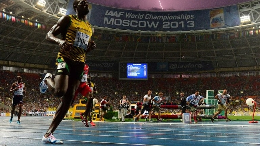 Jamaica's Usain Bolt wins the 100 metres final at the 2013 IAAF World Championships at the Luzhniki stadium in Moscow on August 11, 2013.The men's 100 metres may have been rocked by a series of doping scandals but the event still has the ability to get the world watching, Donovan Bailey said on Wednesday.