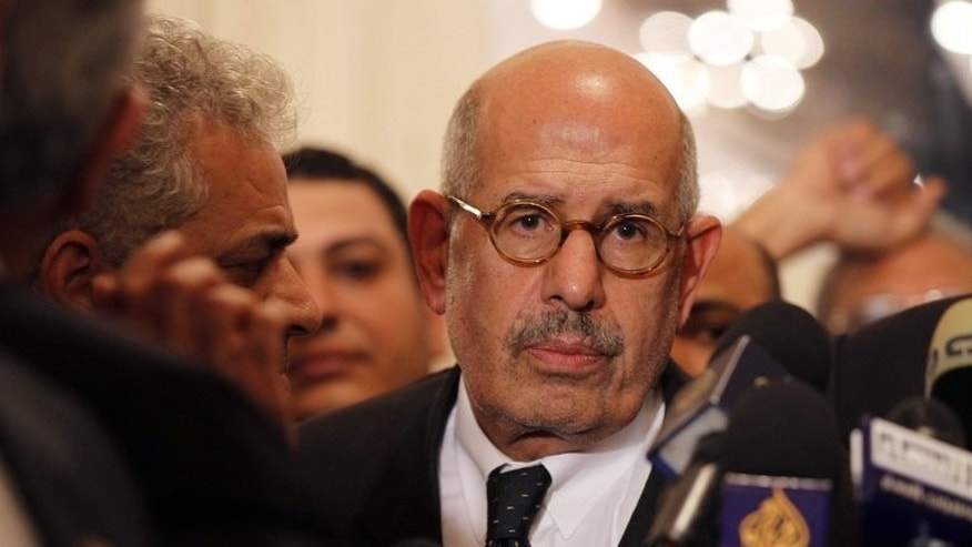 Egyptian opposition leader and Nobel Prize laureate Mohamed ElBaradei leaves a joint press conference on November 22, 2012 in Cairo. ElBaradei announced his resignation on August 14, 2013 in a letter to the interim president.