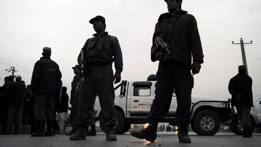Afghan policemen are pictured during a road block in Kabul on January 26, 2010. An unknown gang has kidnapped a female Afghan member of parliament, officials said Wednesday, in the latest example of prominent women being targeted.