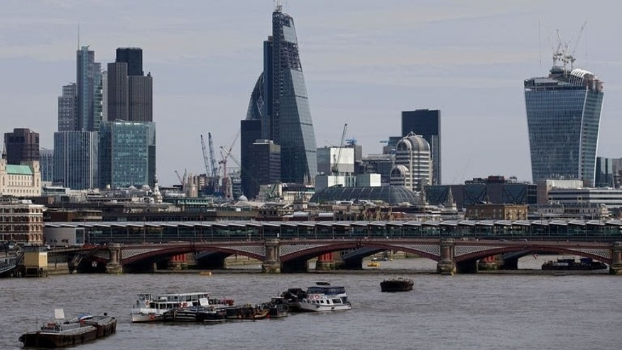 A general view of the City of London skyline pictured on August 7, 2013. London shares were lower on Wednesday weighed down by a string of blue-chip companies going 'ex-dividend' traders said.
