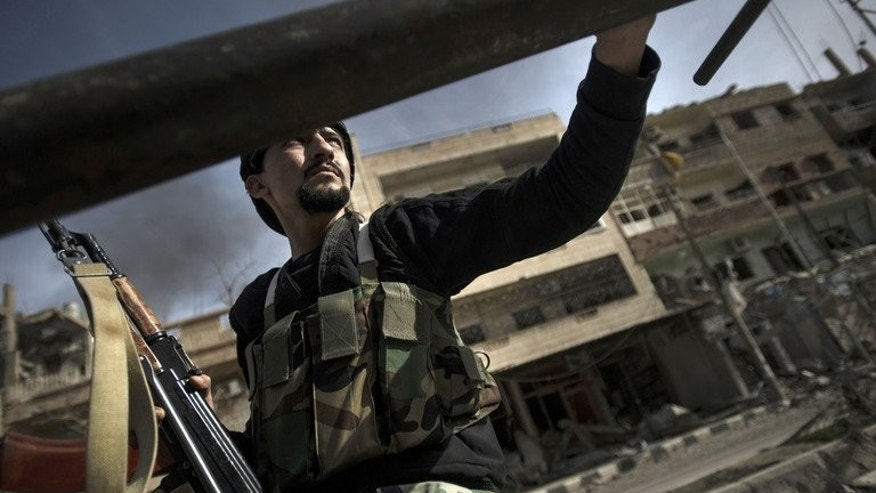 A Free Syrian Army fighter moves during clashes with regime forces on February 28, 2013 in Deir Ezzor. A jihadist group has expelled rebel Free Syrian Army fighters from their positions in the northern city of Raqa, a watchdog reported on Wednesday.