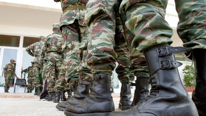 Mauritanian soldiers stand in line to vote at a polling center in Nouakchott on March 25, 2007. Mauritania said it would send soldiers to the United Nations peacekeeping force charged with ensuring security after elections in conflict-scarred Mali -- but only to areas near their shared border.