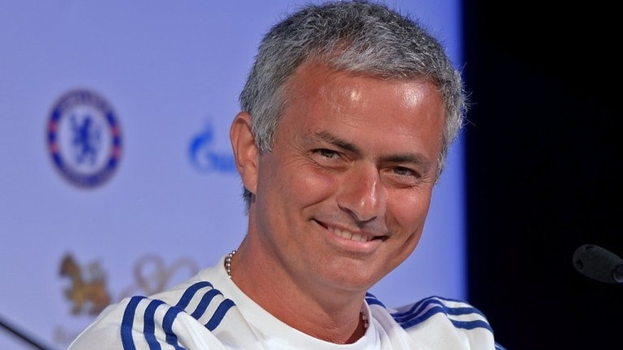 Chelsea manager Jose Mourinho smiles during a press conference in Bangkok on July 16, 2013. With the new Premier League campaign kicking off this weekend, he has spent the last few days fine-tuning his preparations for the Blues' opening game against Hull City on Sunday.