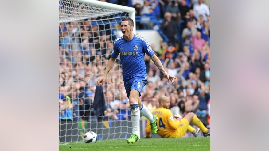Chelsea's Fernando Torres celebrates after scoring during their Premier League match against Everton on May 19, 2013. Manager Jose Mourinho has focused on implementing his tactical plan, which is likely to revolve around a 4-3-3 system featuring Torres in the central striking role.