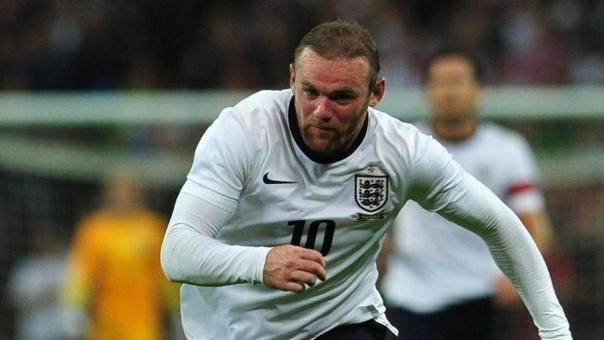 England striker Wayne Rooney pictured during an international friendly against Scotland at Wembley Stadium on August 14, 2013. Chelsea manager Jose Mourinho still hopes to sign unsettled Rooney despite two unsuccessful bids.