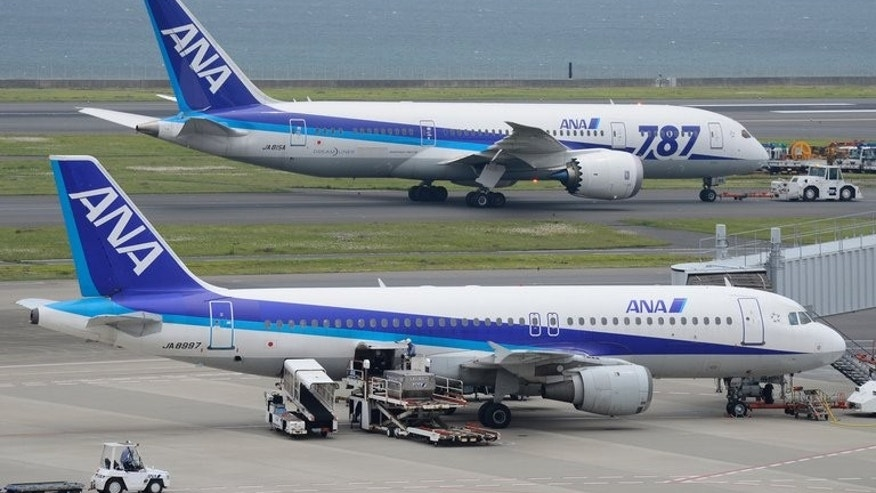 A Dreamliner passenger plane (top) of Japan's All Nippon Airways (ANA) is towed on the tarmac at Haneda Airport in Tokyo on April 30, 2013. ANA said Wednesday it had found defective wiring in a fire-extinguishing system on three of its Boeing Dreamliners, prompting rival Japan Airlines to abort a Helsinki-bound flight.