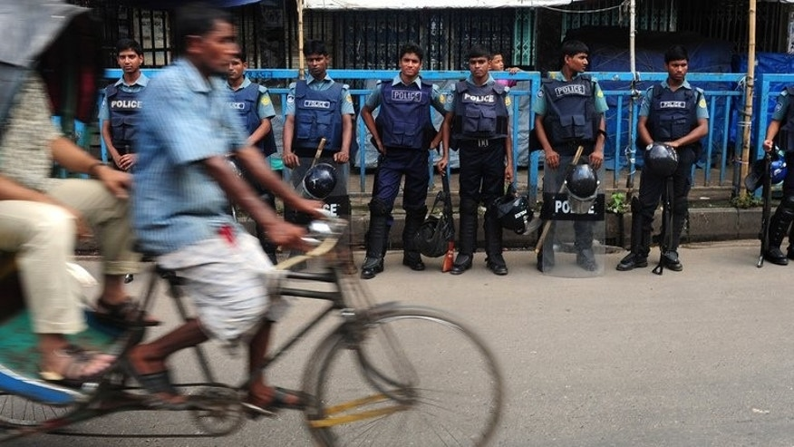 Police stand guard in Dhaka during a nationwide strike called by Bangladesh's largest Islamist party on August 13, 2013. One man died as police and supporters of Jamaat-e-Islami clashed Wednesday during the strike in Dhaka.