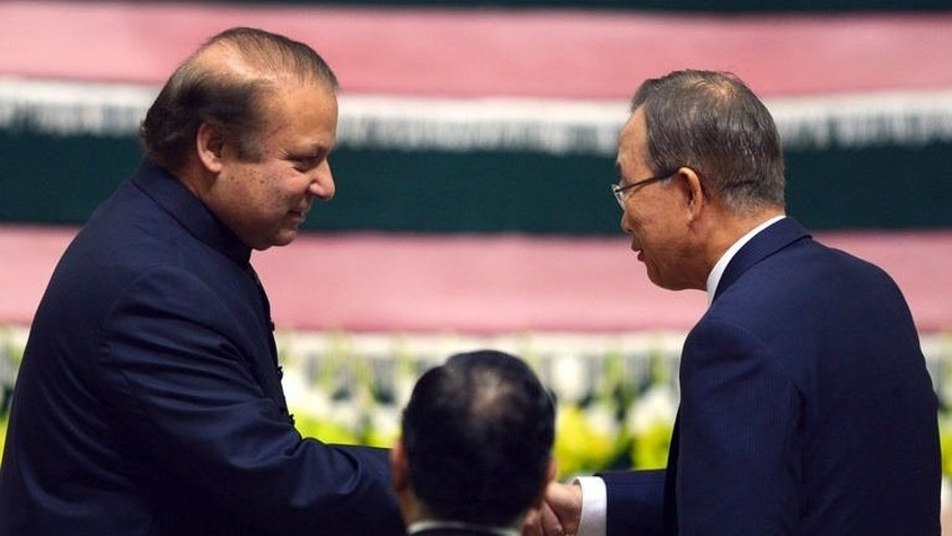 "Pakistani Prime Minister Nawaz Sharif (left) shakes hands with UN Secretary-General Ban Ki-moon during a ceremony to mark the country's Independence Day in Islamabad, on August 14, 2013. Sharif has pledged to respond to rising tensions in disputed Kashmir with ""restraint and responsibility"" as officials accused India of killing another civilian by firing across the border."