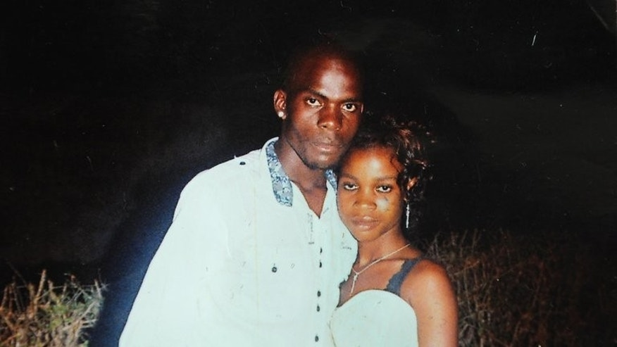 A file photo of Mozambican taxi driver Mido Macia with his sister Melida Macia. A South African court has freed on bail nine policemen accused of murdering Macia who was dragged behind a police van and then brutally beaten to death.