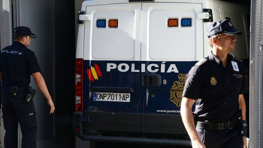 A Spanish police van carrying convicted child rapist Spaniard Daniel Galvan arrives at a courthouse in Madrid on August 6, 2013. Galvin jailed in Spain after he was controversially freed by the King of Morocco will appear before a judge in late August on historic abuse charges.
