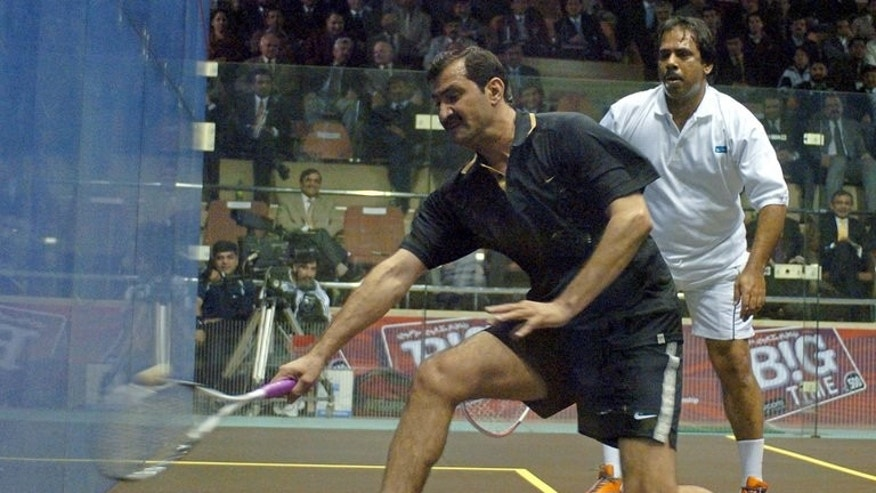 "Pakistani squash legends Jahangir Khan (right) and Jansher Khan play during a friendly match at the Mushaf Squash Complex in Islamabad, 14 December 2005. Khan says the country must do more to improve its image and stop the rest of the world thinking of Pakistanis as ""terrorists""."