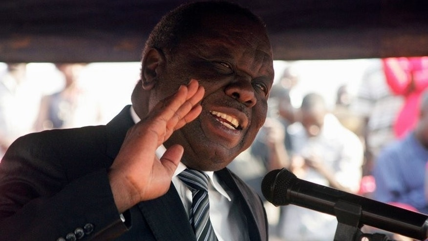 Zimbabwe opposition leader Morgan Tsvangirai addresses mourners during the burial of Rebecca Mafikeni, a party activist of the MDC on August 14, 2013 in Harare. Morgan Tsvangirai claimed on Wednesday that veteran President Robert Mugabe had attempted to talk to him after last month's disputed elections.
