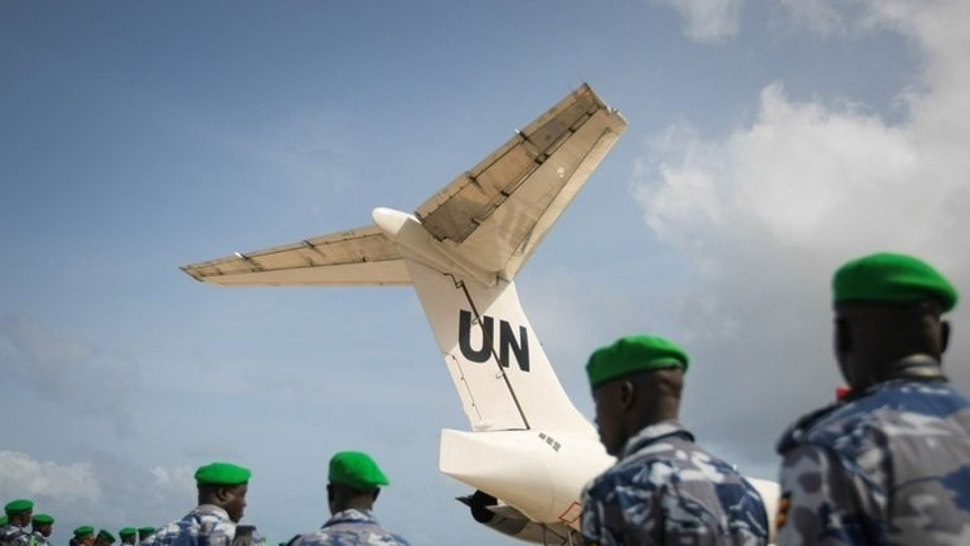 African Union Mission in Somalia (AMISOM) troops prepare to board a UN aircraft in Mogadishu last month. The African Union force fighting in Somalia is investigating the alleged gang rape of a woman by its soldiers, a case that has sparked outrage in Mogadishu, the AU said Thursday.