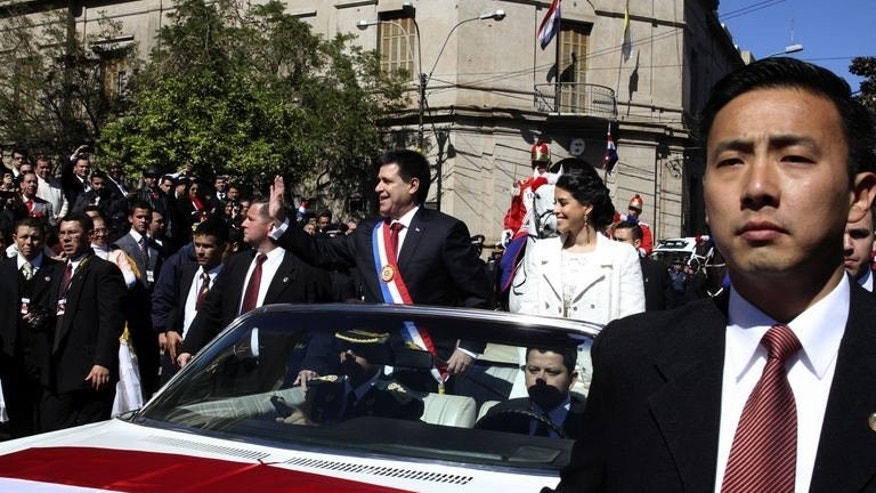 New Paraguayan President Horacio Cartes and his daughter Sofia after his inauguration in Asuncion, on August 15, 2013. Conservative businessman Horacio Cartes was sworn in as president of Paraguay Thursday, amid slowly improving relations with South American neighbors damaged by the 2012 ouster of leftist president Fernando Lugo.