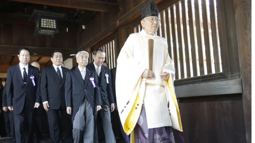 August 15, 2013: Japanese lawmakers visit the Yasukuni Shrine in Tokyo to offer prayers. Japan is marking the 68th anniversary of its surrender in World War II with somber ceremonies and visits by senior politicians to the shrine honoring 2.5 million war dead that remains a galling reminder to many of colonial and wartime aggression. (AP Photo)