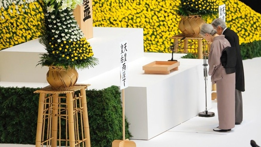Aug. 15, 2013: Japan's Emperor Akihito and Empress Michiko offer silent prayers for the war dead in front of the main altar decorated with huge bank of chrysanthemums during a memorial service at Budokan Martial Arts Hall in Tokyo, marking the 68th anniversary of its World War II surrender.