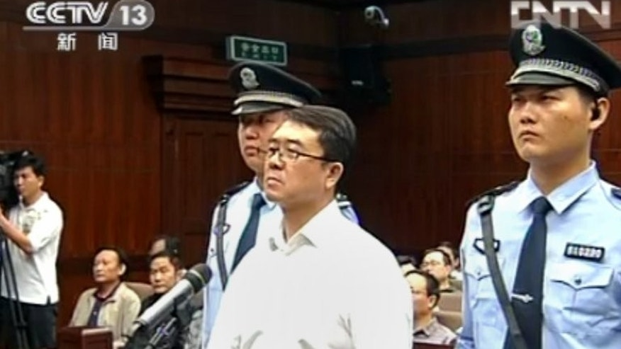 A CCTV frame grab from September 24, 2012 shows former police chief Wang Lijun (C) in court in Chengdu. Wang was the chief of police in the southwestern metropolis of Chongqing when he fled to a US consulate in Chengdu, allegedly to seek asylum, blowing open China's biggest political scandal in years.