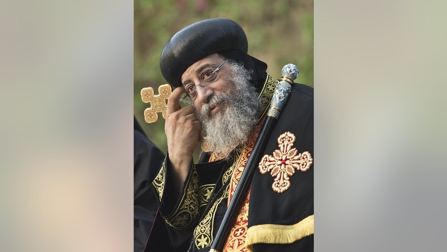 Leader of Egypt's Coptic Christians Pope Tawadros II, pictured during the 60th anniversary celebration of the Dominican Institute for Oriental Studies in Cairo, on June 9, 2013. Egypt's Christians are living in fear after a string of attacks against churches, businesses and homes they say were carried out by angry supporters of ousted Islamist president Mohamed Morsi.
