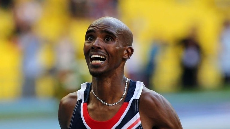 Great Britain's Mohamed Farah celebrates winning the men's 10,000 metres final at the 2013 IAAF World Championships at the Luzhniki stadium in Moscow on August 10, 2013. AFP PHOTO / ADRIAN DENNIS