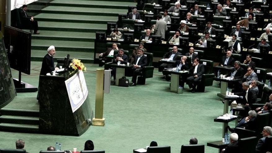 Iranian President Hassan Rowhani speaks during a parliament session to elect the cabinet members on August 15, 2013 in Tehran. Iran MPs approved 15 of Rowhani's 18 cabinet picks.