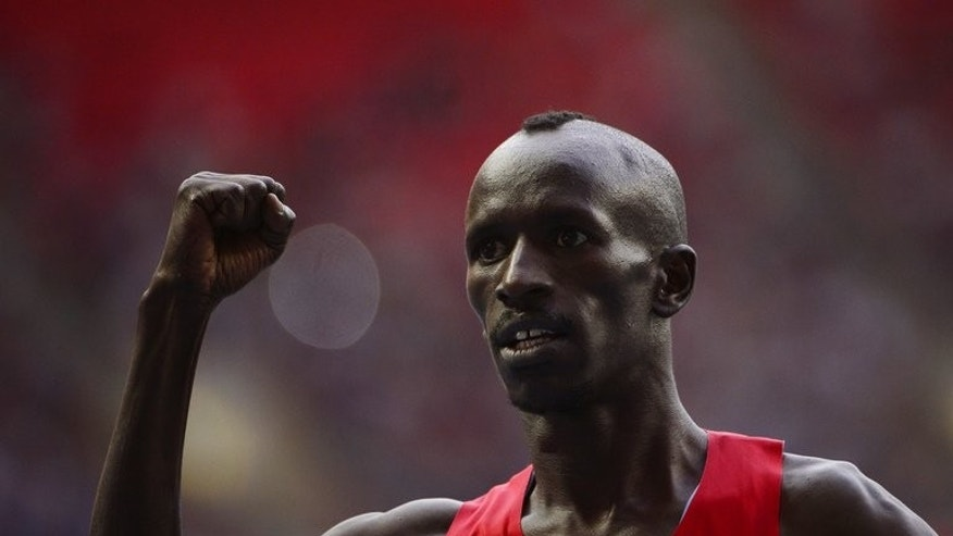 Kenya's Ezekiel Kemboi celebrates after winning the men's 3000 metres steeplechase final at the 2013 IAAF World Championships at the Luzhniki stadium in Moscow on August 15, 2013.