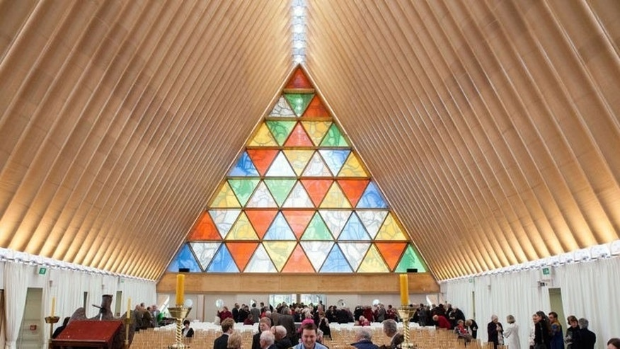 Image taken by Bridgit Anderson on August 4, 2013 shows the first service held inside Christchurch's cardboard cathedral. Despite the unusual building material, it has a design life of 50 years, with the Anglican Church planning to use it as a cathedral for at least a decade.