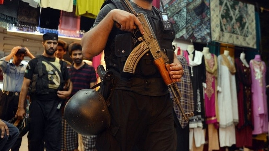 A Pakistani police commando patrols in Islamabad on August 7, 2013. Police in Islamabad are locked in a stand-off with a man armed with two automatic guns who was randomly firing in the air in the Pakistani capital Thursday.