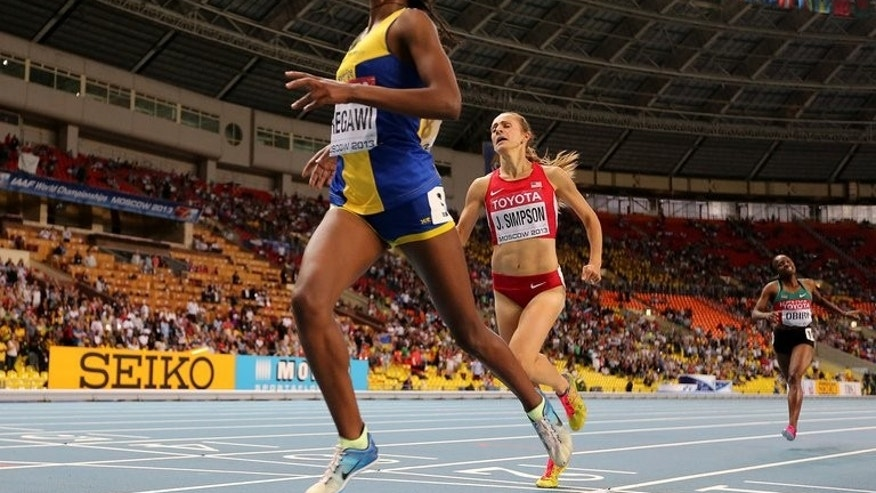 Sweden's Abeba Aregawi (L) wins the women's 1500 metres final at the 2013 IAAF World Championships at the Luzhniki stadium in Moscow on August 15, 2013.