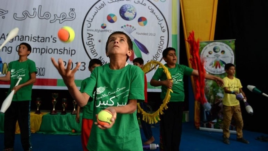 Young jugglers perform during the 8th Afghanistan Juggling Championships in Kabul, on August 14, 2013. The championships brought together about 100 extremely talented children who had won through to the grand final from heats staged in seven provinces across war-torn Afghanistan.